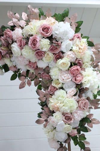 Artificial blush pink flower arch arrangement