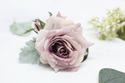 Mauve flower grooms buttonhole