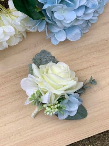 Nicole  Ivory Cream Blue Rose Corsage